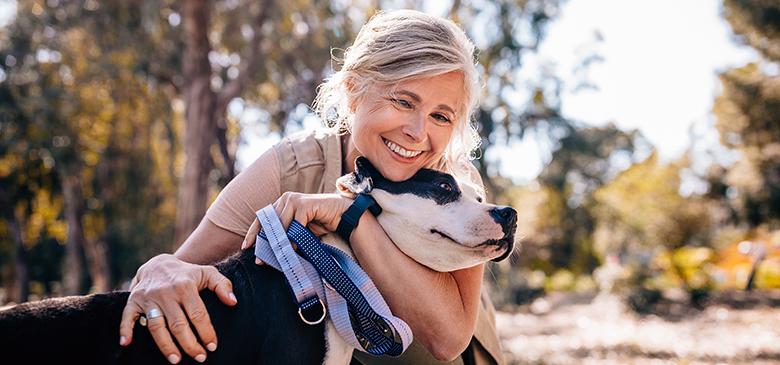 Women cuddling a dog